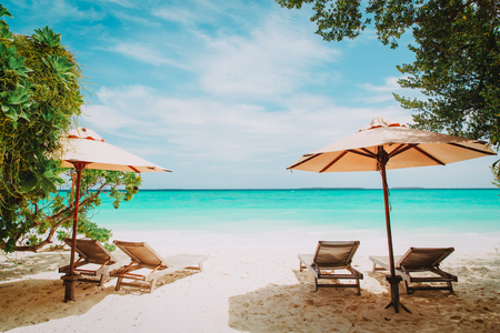 Beach chairs on tropical vacation Stock Photo