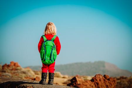 little girl hiking in mountains, family travel 版權商用圖片