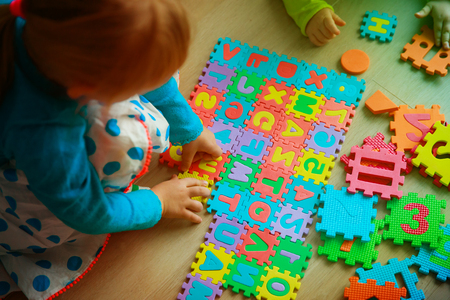 kids playing with puzzle, learning letters and numbers
