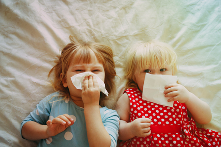 kids wiping and blowing nose Standard-Bild