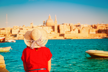 tourist looking at Malta capital in evening