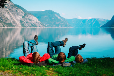 family with kid relax travel in scenic nature