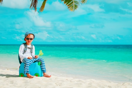 little boy travel on tropical beach