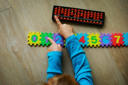 little girl learning numbers, mental arithmetic, abacus