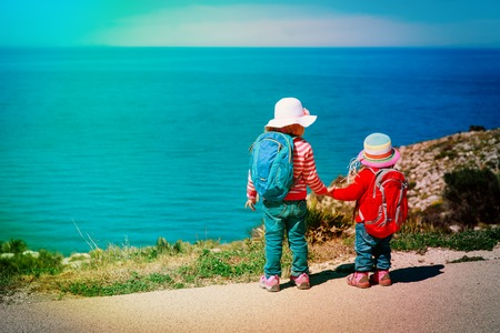 little girls travel in nature, looking at scenic view, family vacation Stock fotó