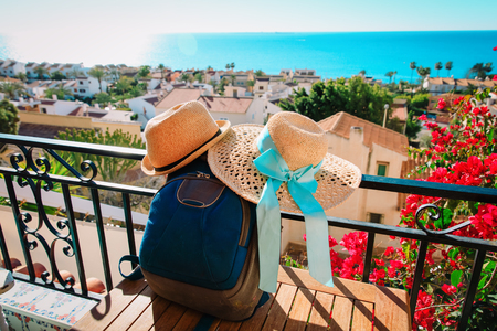 hats and backpack on scenic terrace, vacation in Europe