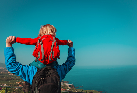 father and little daughter hiking travel in mountains at sea Standard-Bild - 101280057