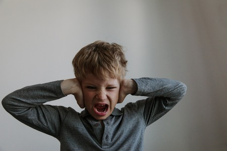 agressive angry conflict child exhausted tired overload Stock Photo
