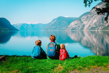 mother with kids travel together, looking at scenic view in Norway