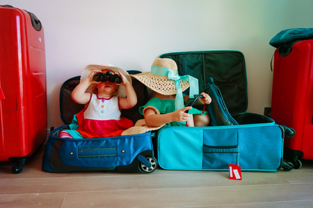 little girls enjoy packing and travel