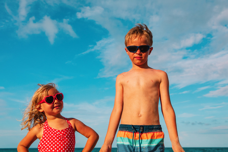 cute little boy and girl go swim on beach Stockfoto