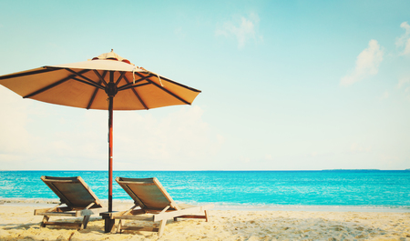 Two beach chairs on tropical vacation, travel concept