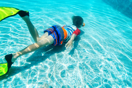 little boy swimming underwater, active kids, water sport