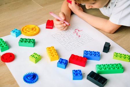 autims awareness- child solving labyrinth, mental health