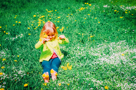 cute little girl with flowers in nature