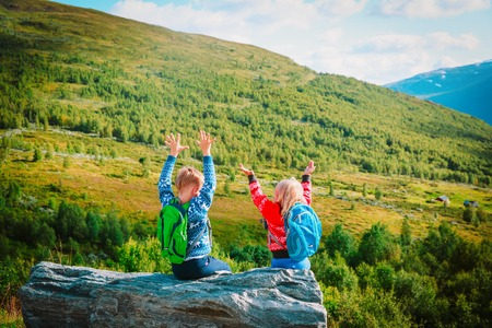 happy little boy and girl travel in nature, family in Norway