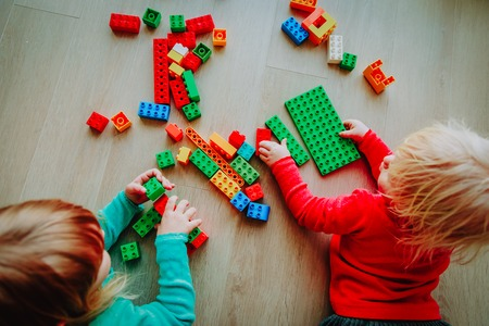 kids play with colorful plastic blocks, education