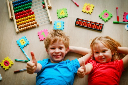 happy kids enjoy learning numbers, arithmetic, abacus calculation