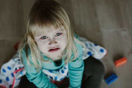 sad crying little girl, pain, stress, exhaustion Stock Photo