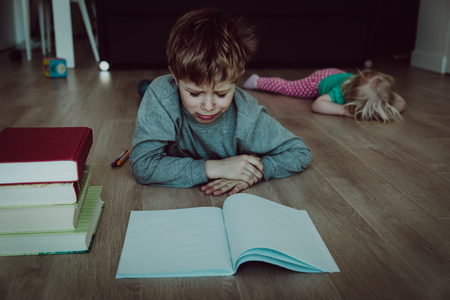 difficult homeschooling- boy tired of homework, sister crying Reklamní fotografie
