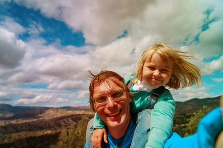 happy father with little daughter making selfie travel in nature Standard-Bild - 107951582