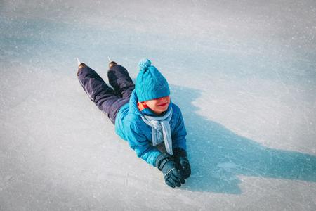 happy boy learning to skate in winter, enjoy sport