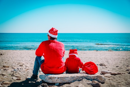 father and baby on winter Christmas beach