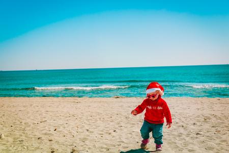 cute little girl on winter Christmas beach Stock Photo