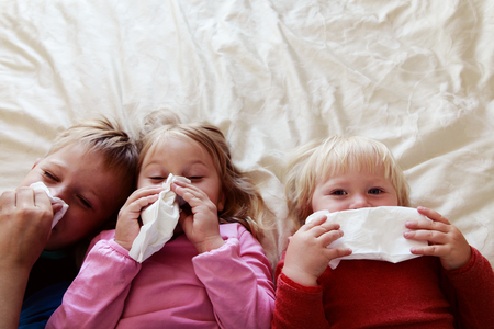 kids wiping and blowing nose, infection or allergy