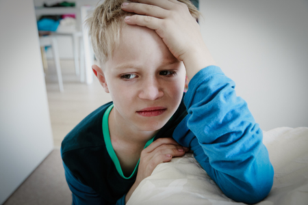 sad child, stress and depression, agressive behaviour at home Reklamní fotografie