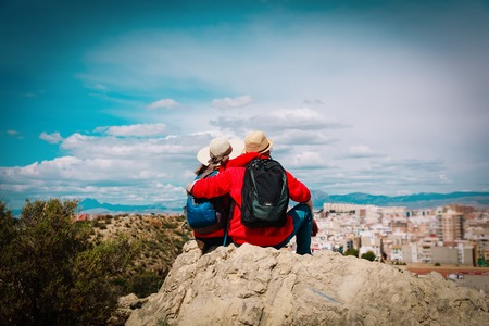 young couple travel in the city looking at panoramic view