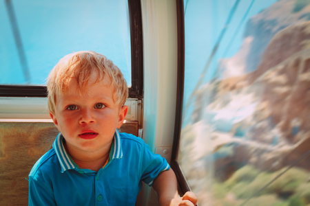 little boy on cable car ride, travel with small kids