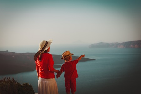 mother and little son looking at view in Santorini, Greece