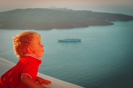 little boy looking at Santorini, Greece, travel concept Stock Photo
