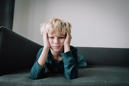 sad child, stress and depression, exhaustion, autism Stockfoto