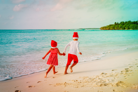 christmas at beach -little boy and girl in having fun at sea