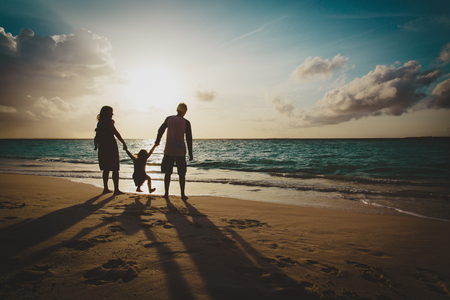 happy family with two kids on play on sunset beach Stock Photo