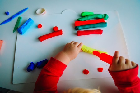 Child playing with clay molding shapes, learning and crafts Reklamní fotografie