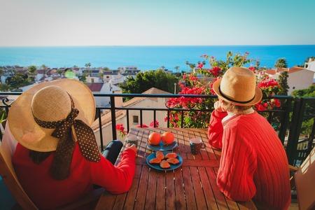 romantic couple having breakfast on balcony terrace with sea view 版權商用圖片