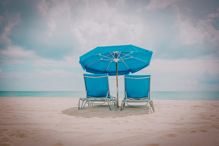 Two beach chairs on tropical vacation at sea Archivio Fotografico