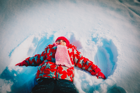 happy little girl enjoy playing in snow