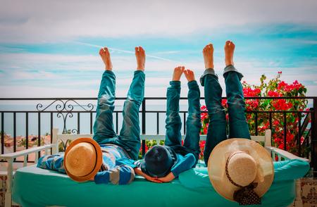 family- mom, dad and son- relax on balcony terrace 版權商用圖片