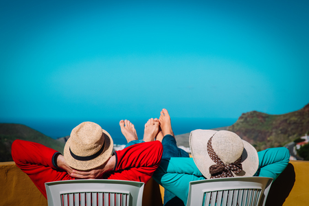 happy couple on vacation near sea and mountains