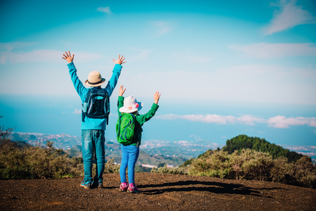 happy little boy and girl travel in nature