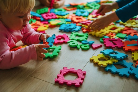 kids playing with puzzle, learning numbers and shapes Stockfoto