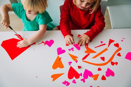 kids making hearts from paper, prepare for valentine day