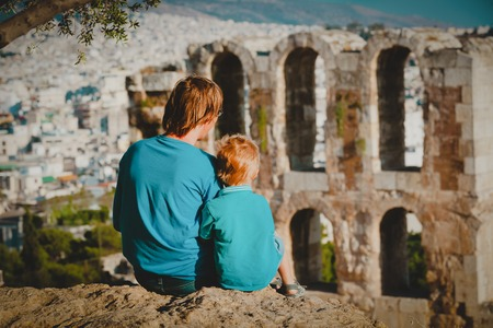 father and little son travel in Acropolis, Athens, Greece
