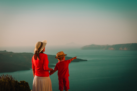 mother and little son looking at caldera in Santorini, Greece