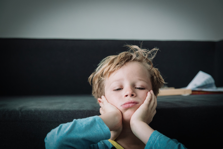 exhausted teenage boy at home, kid in stress Stock Photo