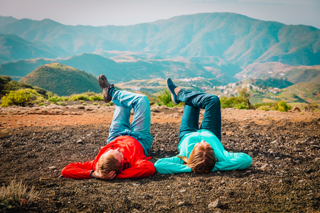young couple relax in mountains, tourists travel in Gran Canaria Stock Photo